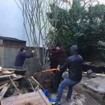 The-guys-maneuvering-the-tree-into-the-ground