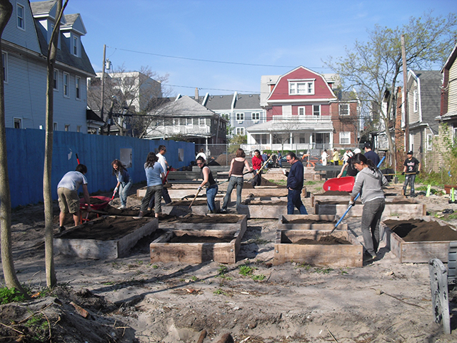 The community was eager to help with the topsoil delivery (May 2011)