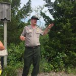 Park Ranger speaking about the Bat structures built in the wildlife preserve JPG