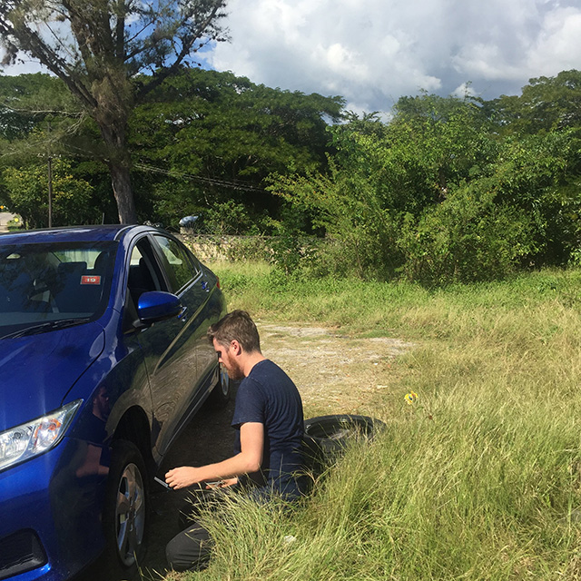 Matt-changing-the-tire,-somewhere-in-Jamaica