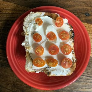 simple sliced tomatoes with cream chease on toasted bread with salt and pepper (1)