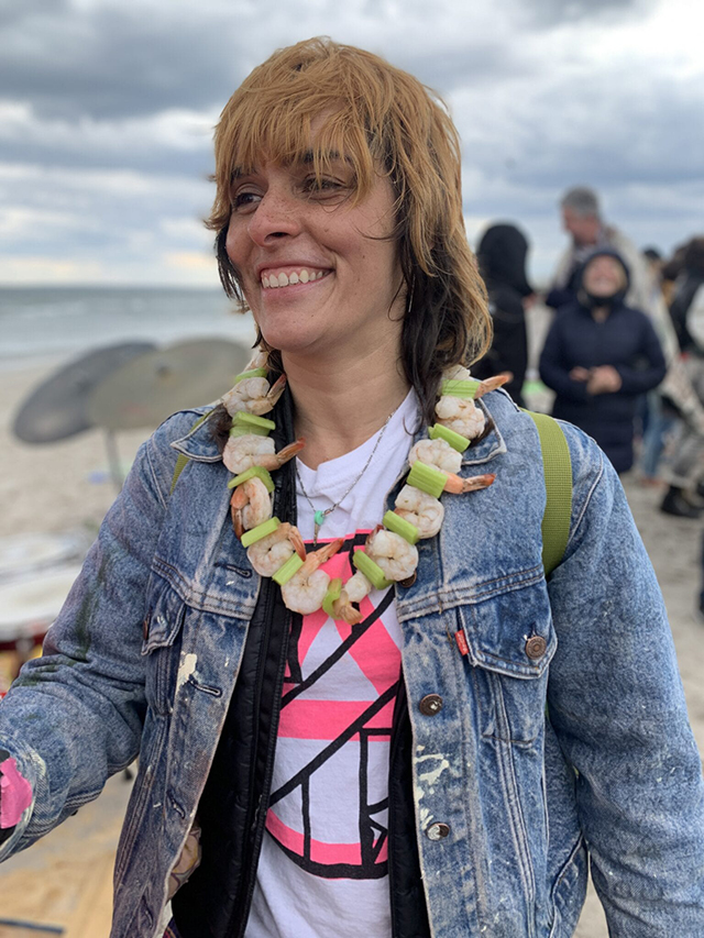 Everyone-wanted-to-try-on-the-shrimp-necklace-made-by-Matt-Johnson.-Teresa-Farrell-posing-for-a-photo-with-the-accessory-1536x2048